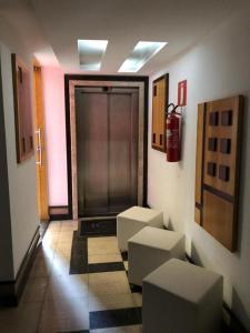 Гостиная зона в Horto Executivo Hotel