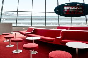 The lounge or bar area at TWA Hotel at JFK Airport