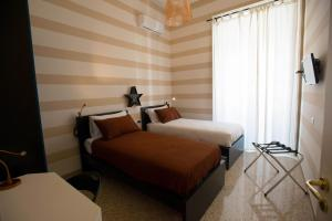 A bed or beds in a room at BEB PALAZZO NATELLA