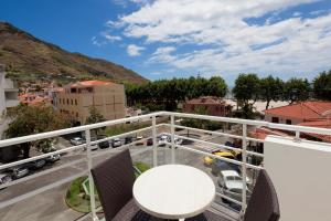 A balcony or terrace at White Waters Hotel