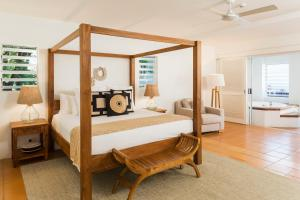 A bed or beds in a room at The Reef House Boutique Hotel and Spa