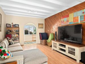 A television and/or entertainment centre at Gone to the Beach - 40 Coogee Ave, The Entrance No