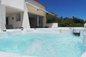 The swimming pool at or near les brisants · les brisants