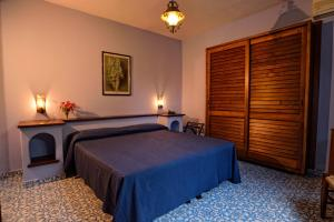 A bed or beds in a room at Gattopardo Park Hotel