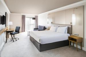 A bed or beds in a room at Crowne Plaza Plymouth, an IHG Hotel