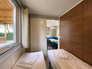 A bed or beds in a room at Camping Serenella