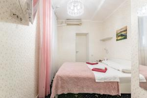 Кровать или кровати в номере Voyage Mini-hotel