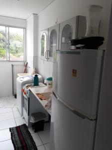 A kitchen or kitchenette at Apartamento Chapada Diamantina
