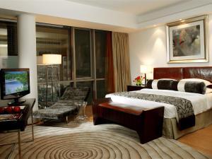 Кровать или кровати в номере Burjuman Arjaan by Rotana - Dubai