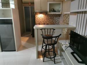 A kitchen or kitchenette at Apartemen Cibubur Village by ARSAKHA PROPERTY