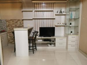 A television and/or entertainment centre at Apartemen Cibubur Village by ARSAKHA PROPERTY