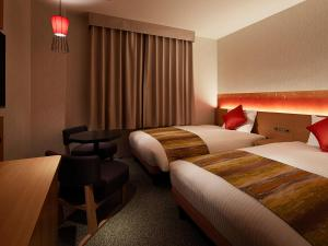 Un ou plusieurs lits dans un hébergement de l'établissement Mitsui Garden Hotel Kyoto Sanjo