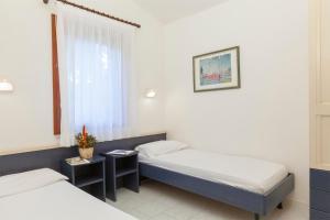 A bed or beds in a room at Villaggio Turistico Internazionale