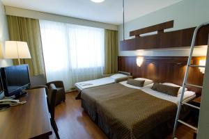 Кровать или кровати в номере Spa Hotel Rauhalahti