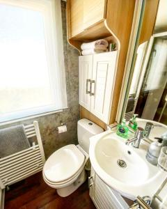 A bathroom at Quintessential British seaside property in Norfolk