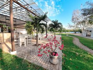 A garden outside Hotel Casa de Campo Conkal Merida