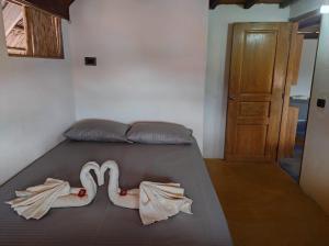 A bed or beds in a room at La Posada del Gecko