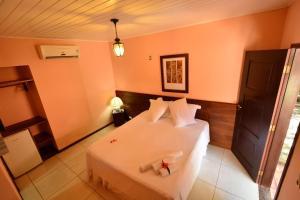 A bed or beds in a room at Encantes do Nordeste