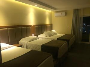 A bed or beds in a room at Itatiaia Resort & Eventos