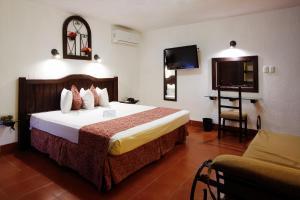 Cama o camas de una habitación en Hotel Maya Yucatan
