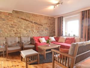A seating area at Cozy Holiday Home in Heppenbach with Meadow View