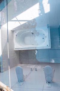 A bathroom at Recanto dos Pássaros