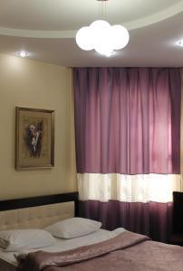 Кровать или кровати в номере Отель Афалина