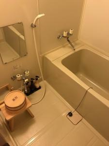 A bathroom at Takinoya Bekkan Tamanoyu