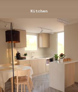 A kitchen or kitchenette at The Farm Chalet