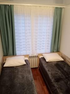 A bed or beds in a room at Рассказовка 2