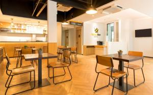 A restaurant or other place to eat at Yellow Bee Tanah Abang