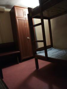 A bunk bed or bunk beds in a room at Pershyy Hostel u Cherkasah