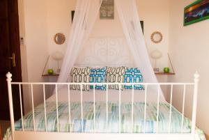 Letto o letti in una camera di Casa Danilo
