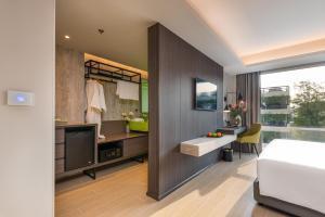 A kitchen or kitchenette at Maitria Hotel Rama 9 Bangkok - A Chatrium Collection