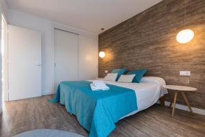 Letto o letti in una camera di Apartamentos Playa Canutells