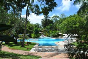 The swimming pool at or near Hotel 7 Colinas