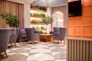 Uma área de estar em Theatrum Hotel Baku