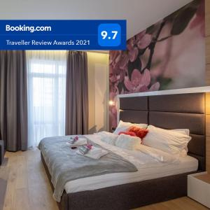A bed or beds in a room at Vitosha Boulevard Two Bedroom Two Bathroom Lux Suite