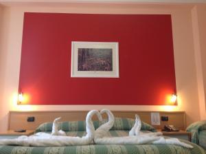 Letto o letti in una camera di Hotel La Pergola