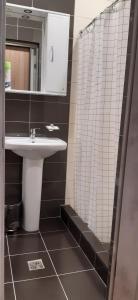 Ванная комната в Три Звезды Отель