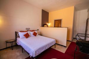 Un ou plusieurs lits dans un hébergement de l'établissement Auberge Sahara
