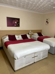 A bed or beds in a room at The Railway Sleeper Lodge