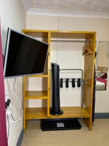 A television and/or entertainment center at The Railway Sleeper Lodge
