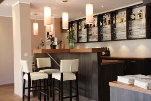 Ein Restaurant oder anderes Speiselokal in der Unterkunft Hotel Stadtidyll & Dependancen
