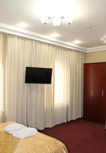 Телевизор и/или развлекательный центр в Отель Афалина
