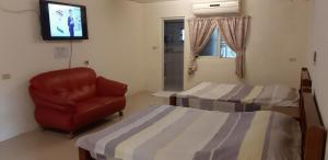 A bed or beds in a room at Cishan San-Ho-Yuan