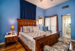 A bed or beds in a room at The Blenman Inn