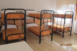 Un ou plusieurs lits superposés dans un hébergement de l'établissement Affittacamere Hostel 3