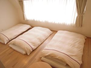 A bed or beds in a room at Okayama View Hotel