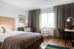 Säng eller sängar i ett rum på Landvetter Airport Hotel, Best Western Premier Collection
